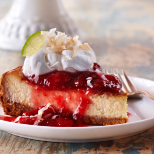 Coconut Lime Cheesecake with Strawberry Sauce
